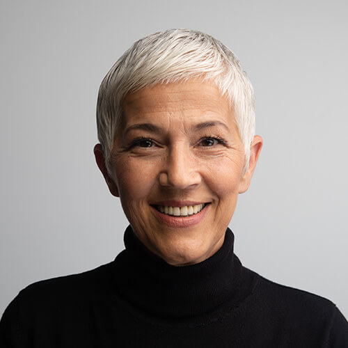 A senior woman with gray hair wearing black shirt