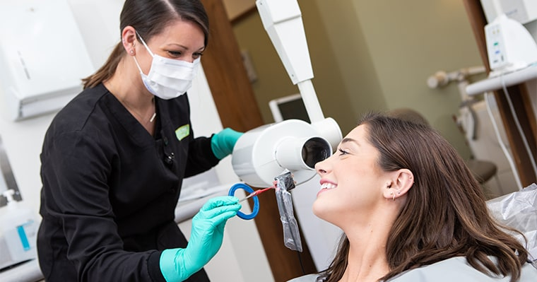 Dental assistant with CEREC patient taking an x-ray
