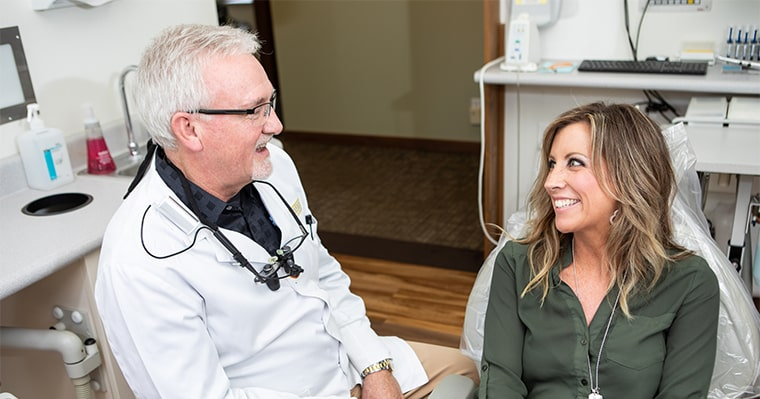 Dr. Kinney discussing CEREC crowns with dental patient.