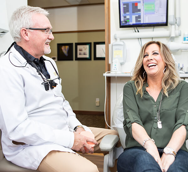 Dr. Kinney in a smile consultation with a patient