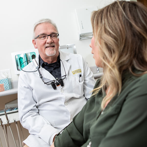 Dr. Kinney in a smile consultation with a female patient